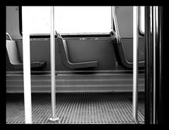 un posto...  per te! (: panti :) Tags: urban bw blackwhite tram bn biancoenero sbarre entrata sedile sedute cronacheurbane