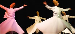 Whirling Dervishes - embracing the world (Teobius) Tags: white turkey spread dance arm muslim religion istanbul ritual ecstasy gown cloth sufi trance dervish ascetic whirling garb mevlevi extasy goldstaraward