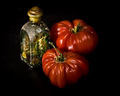 still life with tomato and bottle (David Lloyd Imageworks) Tags: stilllife tomato studio bottle tomatoes herb ripe onblack hierloom strobes davidlloyd antiquebottle davidlloydimageworks dlimageworks