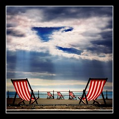 Just Sit and Watch! (adrians_art) Tags: light red sea sky beach water clouds reflections dark geotagged sussex coast shadows searchthebest stripes beam coastal shore promenade rays soe bexhill geotags blueribbonwinner mywinners abigfave diamondclassphotographer megashot superfaveme bratanesque favemegroup11 colourartaward thegoldendreams