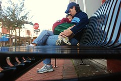 Tired on a bench (7austins) Tags: street bench child sleep mother son sidewalk tired embrace momma tender hold lt sixaustins