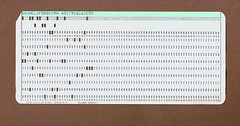 Punch card from Hell... 20060731_3157 (listorama) Tags: gone memory memorabilia stuff missed notforgotten computer card punchcard hollerithcard ibmcard programming fortran college recycling lists number numbers row column matrix array globe paper cardboard dbnotes