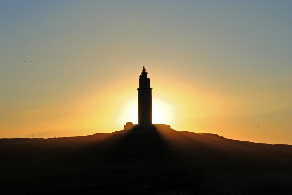 Lighthouse eclipse. Tower of Hercules probably the only ancient Roman lighthouse still in use, located in the city of A Coruña, Spain.