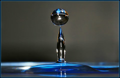 Blue waterdrop (black_z) Tags: blue water reflections waterdrop flash drop splash waterdrops refractions starbursts platinumphoto