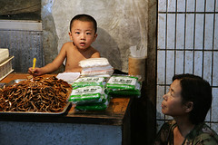 Small seller (Pawel Boguslawski) Tags: china street stella people canon asia child market pasta xian noodle 400d