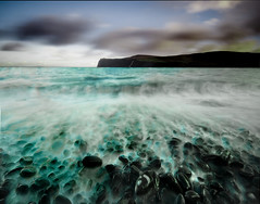 Wave Receeding (Corica) Tags: uk longexposure greatbritain sea skye scotland waterfall waves glendale britain stones wave pebbles isleoflewis receeding sigma1020mm lochpooltiel wetthrough theminch milovaig canon400d lowermilovaig
