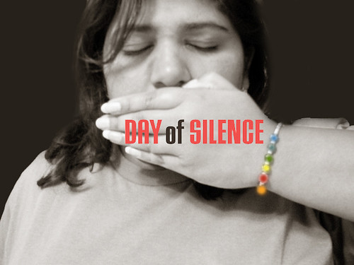National Day of Silence supporter putting her hand over her mouth.