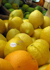 Lemons (Ruth and Dave) Tags: orange yellow fruit vancouver market stall lemons citrus lime granvilleisland spuds