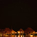 Night sky over overwater bungalows