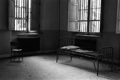 Loneliness in cage (About a Majordomo) Tags: bw white black bed loneliness decay spiderweb cage hp5 3200 asylum bianco sedia ilford nero letto mental urbex gabbia abbandoned abbandono abbandonato ragnatela supershot istituto 10faves passionphotography 25faves psichiatrico bnperiferia solitudini ultimateshot bnreportage hourofthediamondlight espressionidellanima