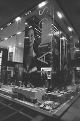 Bookstore (Sergio) Tags: bw white black window corner hellas center athens bookstore greece kodaktmax400 attica nikonfa pushedto1600 ianos nikkornauto24mmf28