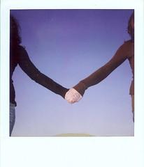 (jessica grady) Tags: blue sky love film sisters polaroid twins hands friendship 600 bond instant