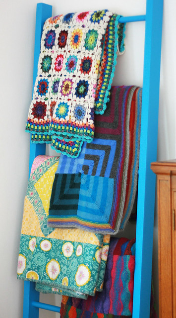 crocheted blanket in it's new home on the blanket ladder.