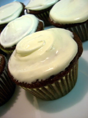 Gingerbread cupcakes are swirled with a cardamom cream cheese frosting ...