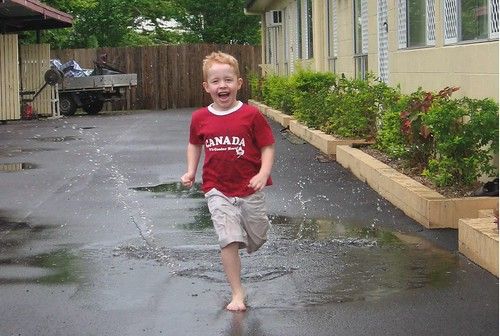 Caleb Running Through the Puddles