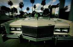 Cadillac Eldorado Convertible (s0ulsurfing) Tags: blue light shadow sky usa cloud sunlight motion blur classic car clouds america vintage wow reflections palms slick cool movement focus classiccar skies dof thankyou bright florida zoom bokeh pov unitedstatesofamerica wide perspective january convertible wideangle funky headlights palm cadillac eldorado grill palmtrees bumper chrome american palmtree surfboard longboard 70s americana dukesofhazzard spaceship collectible jupiter pimp 2008 fla radiator caddy collectable southflorida pimped 10mm sigma1020 supershot s0ulsurfing abigfave aplusphoto cadillaceldoradoconvertible