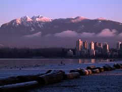 Kits Beach (Lloyd K. Barnes Photography) Tags: morning moon mountains beach vancouver clouds sunrise fullmoon urbannature kits kitsilano moonset zd 40150mm interestingness407 i500 urbannatureblog platinumphoto anawesomeshot lloydbarnes exploree20080123 lloydkbarnes