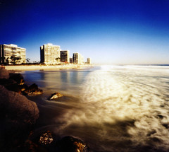 the golden waves of coronado (manyfires) Tags: california sea film beach island hotel 2000 waves sandiego shoreline pinhole pacificocean coronado zero zero2000 zeroimage palabra