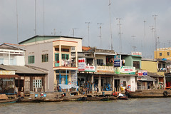 Riverside homes (coolground) Tags: house boat vietnam mekongdelta 2008 antenna mekong mekongriver caibe nikond40