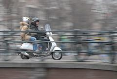 At The Speed of Lite (FaceMePLS) Tags: amsterdam vespa nederland thenetherlands streetphotography scooter brug panning helmets tweewieler helmen nikond200 straatfotografie windscherm facemepls