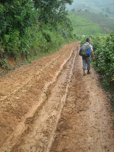 Mr. Kaye lead the way on a road near Kalaw