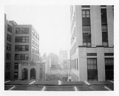 Midtown (Xylographile) Tags: nyc newyorkcity blackandwhite bw newyork architecture buildings mediumformat polaroid manhattan midtown overexposed artdeco instantphotography edifice polaroidlandcamera polaroid660 peelapartfilm instandfilm