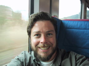 On a train to Prague with full beard and long hair, 2001.