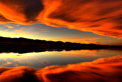 Sunset Reflected (Thad Roan - Bridgepix) Tags: statepark sunset orange foothills lake mountains reflection water clouds colorado denver explore chatfield littleton 200711