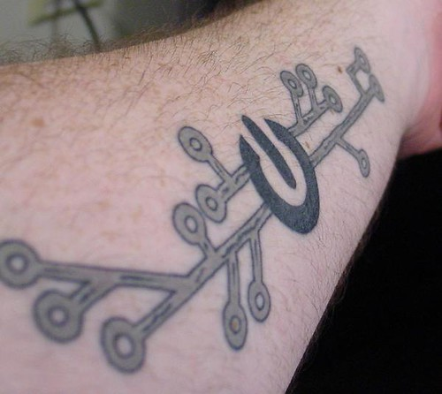 Power symbol and circuit trace tattoo