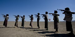 Afar war dance with kalashnikovs, Danakil, Ethiopia (Eric Lafforgue) Tags: africa people blackandwhite horizontal photography dance gun day african fulllength culture tribal weapon warrior tradition ethiopia tribe ethnic adultsonly tribo ak47 hornofafrica ethnology afar eastafrica thiopien etiopia ethiopie realpeople etiopa largegroupofpeople  traveldestination danakil etiopija pastoralist ethiopi  etiopien etipia kalachnikov  etiyopya  mg1701 peopleinarow unrecognizableperson   asaita  assayta