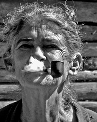 Smoking Old Lady (Michelle Brea) Tags: old bw art texture lady photography moments dominican photographer artistic dominicanrepublic dr smoke pipe dominicana fotografia capture feelings artista santodomingo michellebrea photodistorzija4
