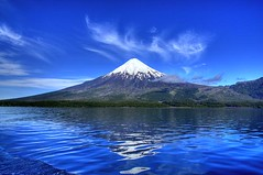 Osorno Volcano, Puerto Montt, Chile (Thad Roan - Bridgepix) Tags: chile blue santiago mountain lake snow water clouds landscape volcano lava photo earthquake landmark glacier explore tsunami soe osorno puertomontt llanquihue blueribbonwinner volcnosorno mywinner 200801 llanquihuelake loslagosregion hdrspotting