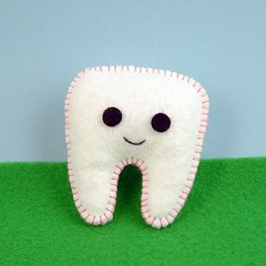 Tiny tooth brooch