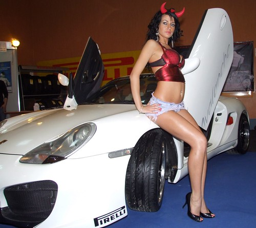 Incredible hot brunette posing with car