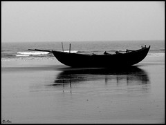 Twins in the sand (Ritu's Lens) Tags: sea bw stilllife india beach lumix boat blackwhite sand panasonic oar bengal fz50 mandarmani