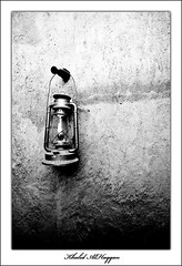 Spread light (Khalid AlHaqqan) Tags: light blackandwhite bw wall canon dark 350d 50mm khalid soe blueribbonwinner mywinners kuwson alhaqqan diamondclassphotographer goldstaraward