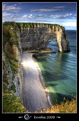 The famous cliffs of Etretat, Normandy - France (Erroba) Tags: blue sea orange cliff sun france green grass clouds photoshop canon belgium cliffs tips erlend normandy soe etretat cs3 themoulinrouge firstquality photomatix tonemapped tonemapping justimagine 400d mywinners anawesomeshot infinestyle bratanesque theperfectphotographer goldstaraward erroba robaye erlendrobaye poseidonsdance artinoneshot francesmasterpieces