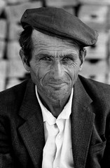 ALBANIA (D J Clark) Tags: travel portrait man hat documentary cap albania korce