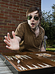 Self Portrait 4 (Hugh Beauchamp) Tags: portrait selfportrait dice sunglasses outdoors action surreal slideshow backgammon strobist