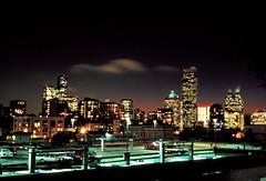 city sky line (intheclearkid) Tags: seattle leica skyscrapers availablelight nightlight 40mm e100vs m6 longshutter nightexposure summicronc filmforlife leicasummicronc40mmf20 cityillumination