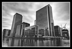 Canary Wharf (Simon Vardy) Tags: city bw london water buildings docklands canarywharf hdr blueribbonwinner westindiadocks tonemapped allrightsreserved 5xp nikond2xs explore346 upperbankstreet allrightsreserved simonvardy nikonafsdx1224mmf4