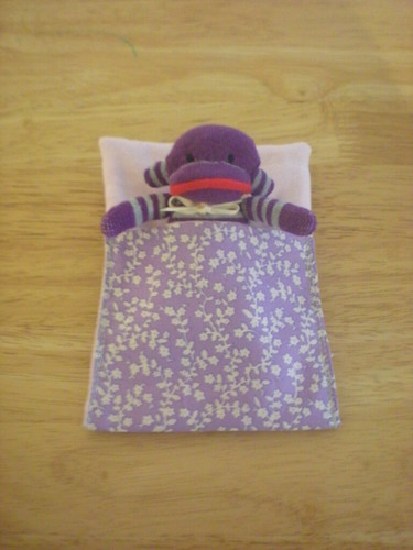 mini sock monkey in sleeping bag
