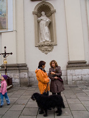 A visit to Cracow (Chris Kutschera) Tags: woman dog pet church poland blessing cracow eglise cracovie ambiance pologne benediction atmosphre