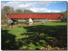 Kissing Bridge (Lisa-S) Tags: bridge blue red sky ontario canada green grass clouds shadows lisas explore coveredbridge allrightsreserved westmontrose blueribbonwinner interestingness379 i500 4115 copyrightlisastokes