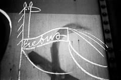 img296 (I'll fight you for that sandwich) Tags: blackandwhite bw erebus art train 35mm graffiti chalk paint noiretblanc tag graf rail delta trains tags rails delta100 streaks chacocanyon hobo ilford freight boxcars krylon t4 fr8 railart yashicat4 moniker paintstick benching ilfosol19 hobotags