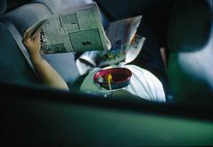 The Art of Multi-tasking (Ann LT) Tags: leica 50mm f10 noctilux backseat kodakektachromee100vs interestingness136 i500 eatandread annlt