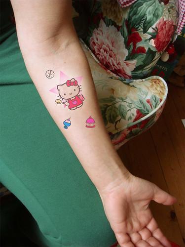 hello kitty tattoos designs. Hello Kitty Tattoo Simulation
