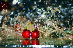 Splish Splash Cherries Taking A Bath (Michelle in Ireland) Tags: red reflection green water fruit cherries impact sensational splash dropped blueribbonwinner cy2 challengeyouwinner abigfave platinumphoto anawesomeshot adoublefave