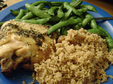 wine-braised chicken, whole wheat cous cous, steamed sugar snap peas