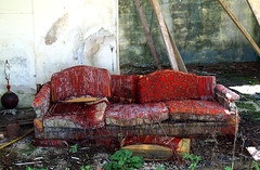 Red Couch (tantrum_dan) Tags: red abandoned station florida interior motel olympus gas couch sandman mims e500 tantrumdan tantrumimagery